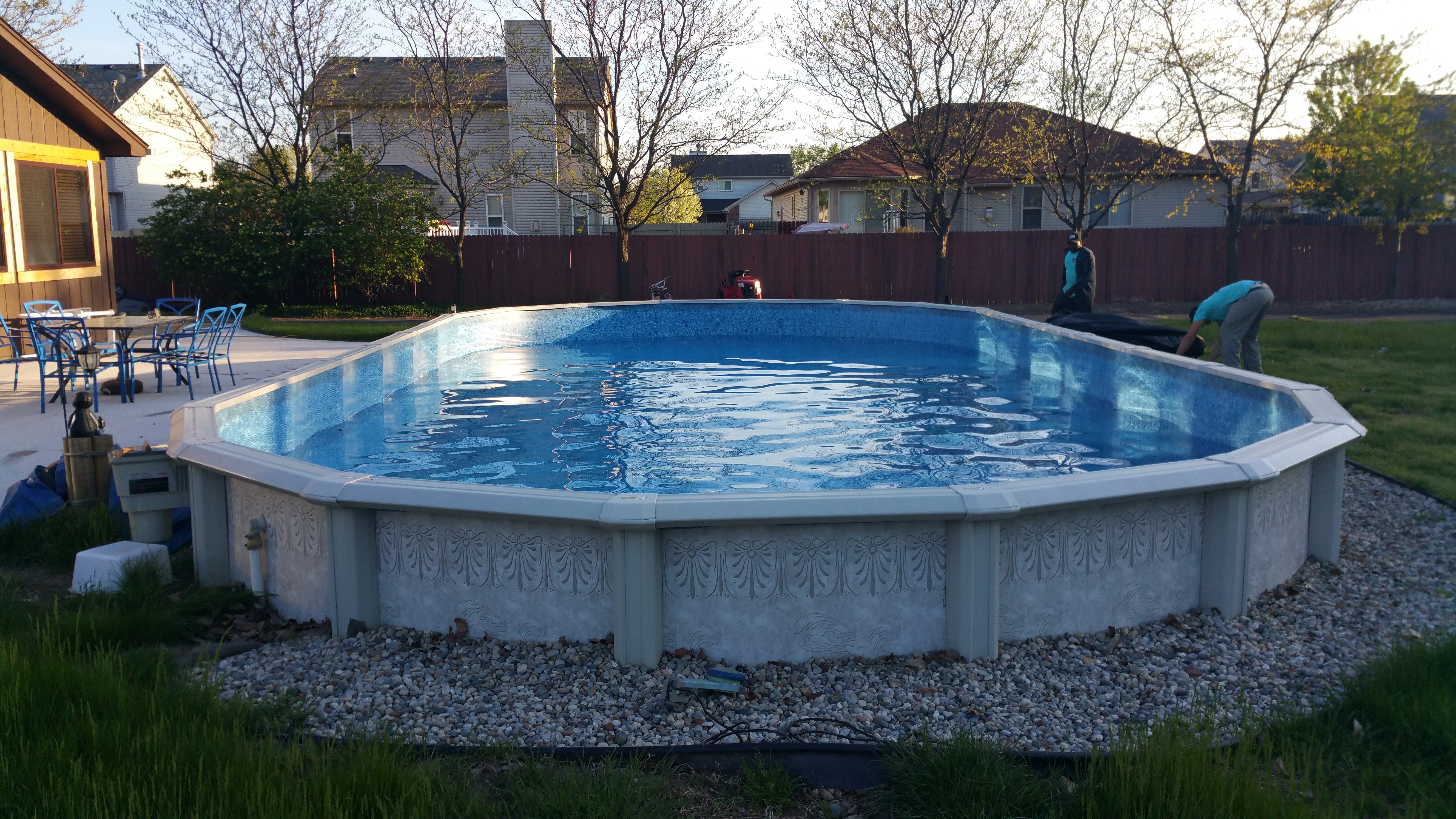 Semi buried aboveground pools crystal clear pools mi for Pool show mi
