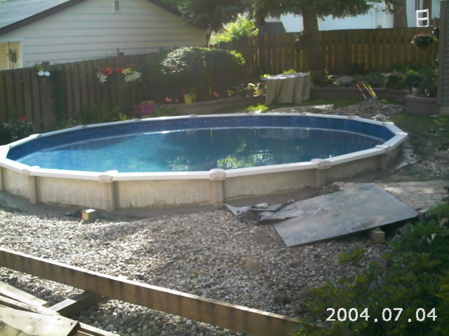 Semi buried aboveground pools crystal clear pools mi for Pool show michigan