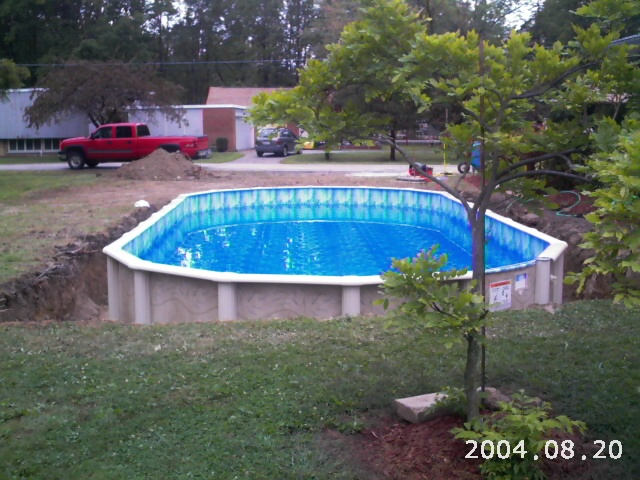 Semi buried aboveground pools crystal clear pools mi for Doughboy above ground swimming pools
